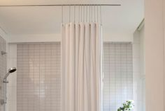 Ceiling mounted shower curtain track