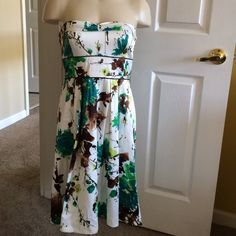 Formal Dress Short formal dress! Blue, green, and brown flower pattern. Ties into a bow in the back. Slight sweetheart neckline. Empire waisted. Worn twice, tiny signs of wear include a few picked threads. Still wonderful condition! Says size 9 juniors, so fits sizes 4-6 women's. Teezeme Dresses