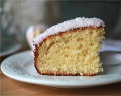 Moist coconut cake with coconut ice frosting: Ingredients: 125g butter, softened 1/2 tsp coconut essence 1 cup castor sugar 2 eggs 1/2 cup (40g) dessicated coconut 1 1/2 cups self-raising flour 250g extra-light sour cream 1/3 cup (80ml) milk Coconut ice frosting 2 cups (320g)icing sugar 11/3 cups (110g) dessicated coconut 2 eggs whites, lightly beaten 1 tbsp water pink food colouring