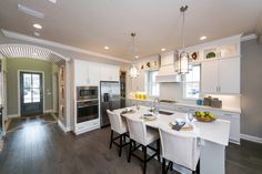 Open-concept floor plans are ideal for families who love to entertain, as well as gourmet kitchens! The Hemingway Model by Dostie Homes in The Crossing at Twenty Mile.