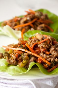 Chinese turkey lettuce wraps.  Lean ground turkey breast, mushrooms sauted in a delicious sauce and topped with carrots, scallions and water chestnuts - all eaten in lettuce cups.  Seriously delicious AND low calorie...a definite winner!