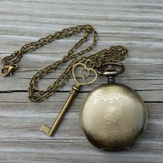 Alice in Wonderland Steampunk pocket watch key pendant charm necklace... ($40) ❤ liked on Polyvore featuring jewelry, necklaces, locket pendant, charm pendant necklace, locket charms, pendant necklace and charm lockets
