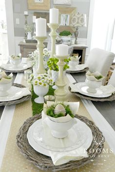 Layered Look:  From the vintage-inspired place settings to the daisies and white candlesticks, this simple, layered look is lovely for Easter.