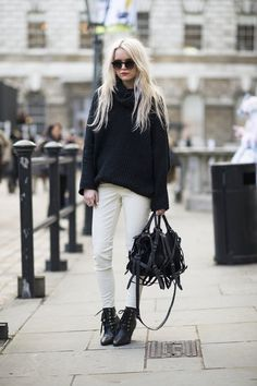 London Calling: 102 of the Chicest Street Snaps From LFW: The texture on her oversize knit and buckles on her bag made this white and black contrast all the more striking.  Source: Adam Katz Sinding