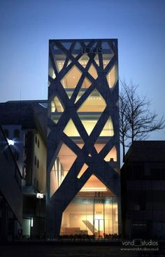 "Tod's Omotesando Building in Tokyo. ""he branching structures aren't merely a two-dimensional lattice on the exterior. They run through the inside, as well, serving as points of interest, section dividers, and even stairways of sometimes unusual gait."" (tokyoarchitecture.info)"