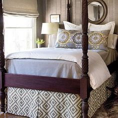 Lovely four poster with attractive fabrics. The grey, taupe, blue & white color scheme is slightly masculine, but not overly so.