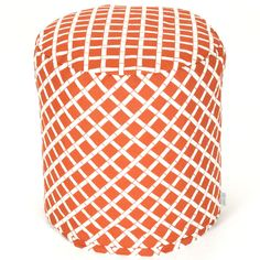A burnt orange pouf ottoman for indoor/outdoor use.