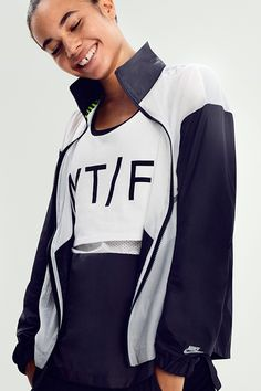 81291dc9bbb9 The Nike Run Track and Field Jacket is bold with graphic black and white  color-blocking.