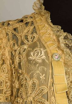 BATTENBURG LACE JACKET, c. 1900 Fine ecru Battenburg lace w/ insertions of embroidered net & Valenciennes lace ruffles, painted china buttons, cream chiffon lining. Detail