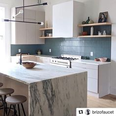 Love this kitchen and especially the contrast stacked backsplash. Been dying to do this! #inspiration #Repost @brizofaucet with @get_repostA calacatta marble waterfall edge countertop and a vertical teal tile backsplash create modern lines in @thefilom