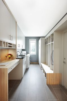 A laundry room is perfect to pair with a mud room. Section off your space with cubbies for mudroom necessities and everything thing else you can dedicate to laundry storage. Modern Laundry Rooms - The Interior Collective Modern Farmhouse Living Room Decor, Modern Laundry Rooms, Modern Farmhouse Interiors, Farmhouse Laundry Room, Laundry Room Design, Modern Room, Minneapolis, Laundry Room Lighting, Tiny House Design