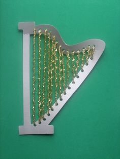 Show your third grader how to string together a pretty, decorative harp.