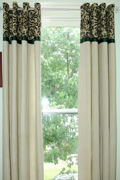 DIY: Canvas Dropcloth Curtains, embellished with coordinating fabric, ribbon, finished with grommets.