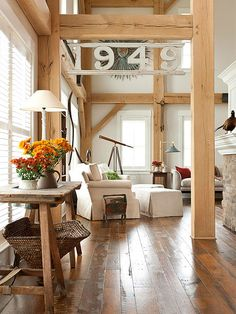 My sister's home. A new timber frame home in Ohio blends a couple's affection for barn-style design, primitive antiques and laid-back country living. Style At Home, Estilo Interior, Sweet Home, Timber Frame Homes, The Design Files, Deco Design, Great Rooms, Living Spaces, Living Rooms