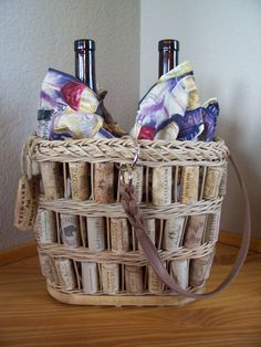 repurposed wine corks incorporated into a handmande basket make a fine wine carrier! basket carries two bottles of your favorite wine or one bottle of wine & two wine glasses. two fabric bottle or wine glass wraps included. beautiful basket Mom! contact me to purchase. $69