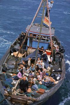 South Vietnamese refugees approach a U.S. war ship to seek refuge from the invading force from the North April 1975 in the South China Sea near Saigon. American involvement in the Vietnam War came to an end when troops from communist North Vietnam invaded Saigon, the capital of the Republic of Vietnam in the South. (Photo by Dirck Halstead/Getty Images)