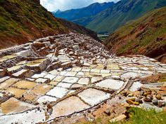 Maras - Since the Inca time this place was used to produce salt. The Incas built terraces where salty water from the mountains runs through. Due to the effect of the sun, the water evaporates and salt remains.