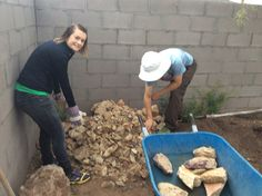 "Emily and Van sort through the rock pile for the ""perfect"" rocks."