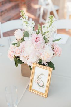 Floral Centerpieces by Lee Forrest Designs with Rifle Paper Co. Gold Framed Table Numbers - Classic Wedding at Cypress Grove Estate House in Orlando, FL - Photo by Amanda Mejias Photography - Click pin for more - www.orangeblossombride.com