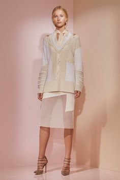 Prabal Gurung Pre-Fall 2016 - Loving the complexity of this ivory and white cable sweater with sections missing from the cable over the shoulders, revealing an ivory satin blouse with attached scarf. The dynamic skirt is cool too but a bit extreme with the sheer panel there