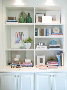 bookshelf styling- maybe remove one shelf in my built ins, put framed artwork in?