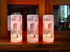 NEW YORK Table Number Luminaries - just add candles - set of 10 (White) on Etsy, Paris Wedding, New York Wedding, Halloween Paper Crafts, Halloween Party, New York Theme, New York Landmarks, Wedding Lanterns, Wedding Table Numbers, Candle Set