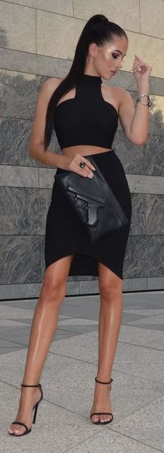 skirt: The Kript | top: The Kript | heels: Stuart Weitzman | clutch: Vlieger and Vandam | cuff: Swarovski