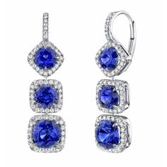 Sapphire and diamond earrings handcrafted with 6.16 carats of round sapphires accented with 0.34 carats of brilliant diamond rounds set in 18K white gold.