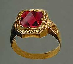 A Burmese spinel ring featuring a nat thwe ('spirit polished') spinel octahedron, which has received only light polishing.  Photo: John McLean; Ring: William Larson Collection