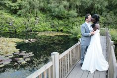 Bride and groom at Spa Hotel on the bridge looking over the pond.
