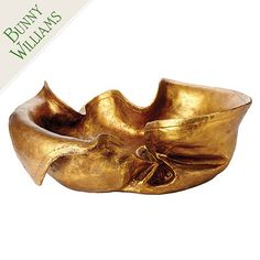 The original version of this gilded sculptural bowl, purchased for one of Bunny Williams' clients, was made of stiffened fabric dipped in gold.