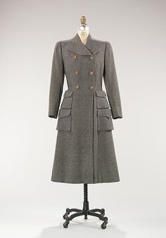 Coat Designer: Mainbocher (American, 1890–1976) Date: 1946 Culture: American Medium: wool Dimensions: Length at CB: 47 1/2 in. (120.7 cm) Credit Line: Brooklyn Museum Costume Collection at The Metropolitan Museum of Art, Gift of the Brooklyn Museum, 2009; Gift of Arturo and Paul Peralta-Ramos, 1954 Accession Number: 2009.300.169
