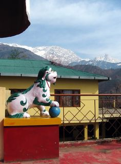 Snow Lion Outside Temple Room of Nechung Monastery, with Dhauladhars in Background