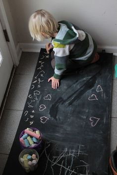 somehow ... a chalk board on the floor for kids to draw on.