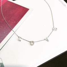 http://jewelure.com/collections/station/products/sterling-silver-love-fashion-necklace