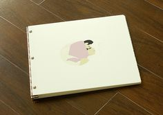 Custom square acrylic portfolio book with engraving and vinyl decal treatments