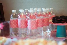 Princess Party Decor.  Use scrapbook paper to cover water bottles. Pinned for:   OR you can get really cute duct tape and use that instead.