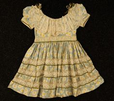 An absolutely adorable little girl's printed silk party dress dating to 1899.