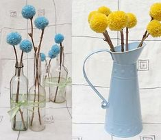 Yarn pom-poms on real branches.  Great centerpiece idea.