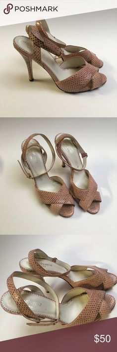 Yves Saint Laurent Pink Snakeskin Crossover Heels Yves Saint Laurent Rive Gauche heels. Overall in good condition, but the black plastic ends on the heels could be replaced, due to wear. Made in Italy, leather soles. Beautiful shoes. Yves Saint Laurent Shoes Heels