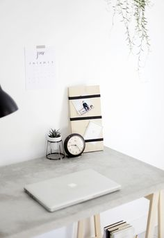 I like this idea for a quick photo display + a DIY Concrete Desk @themerrythought for @homedepot