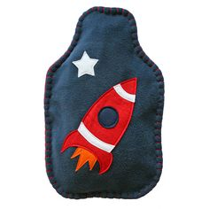 Rocket hot water bottle and cover.
