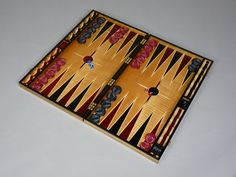 Below is a photo of a tournament size backgammon board Eric McRory made using Brusso'sCB-407 butt hinges. It is one of his most elaborate inlay projects, usingwestern maple veneer, zebra wood, ebony, eastern maple, and bloodwood. Eric has been woodworking as a hobby since age 10, and has his board featured in The Readers Gallery of Fine Woodworking issue # 220.