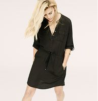 """Lou & Grey Henley Shirtdress - Introducing a new line of easy, texture-rich pieces for your every day. Cinched with a slinky drawstring waist, this fluid piece is so easy to wear. Collarless. Long sleeves with button tab details at cuffs. Henley button placket. Flap chest pockets. Drawstring waist. Front besom pockets. Shirttail hem. 17 1/2"""" from waist seam."""