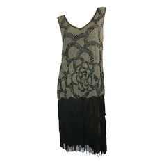 1920s Beaded and Fringe Dress   From a collection of rare vintage evening dresses at http://www.1stdibs.com/fashion/clothing/evening-dresses/