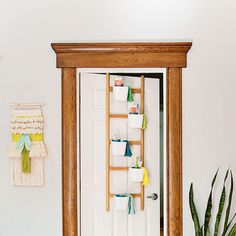 Use a plant stand to create a bedtime routine organizer for the family!