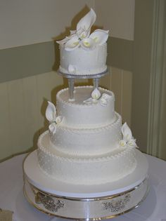 5 inch Crystal Pillars on a Buttercream Wedding Cake.  Cakes By Graham, More than Just the Icing on the Cake.  http://richmondcakes.com/