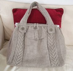 I like the cable on this tote.  Free pattern | Knitted Creations: Cable Tote