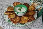 Cabbage Fritters 2 1/2 cups cabbage, finely chopped or grated 1/4 cup finely chopped onion 1/4 cup crumbled cooked bacon 1/2 cup all-purpose flour 1 teaspoon salt 1/4 teaspoon black pepper 2 eggs, lightly beaten 1/4 cup vegetable oil In a mixing bowl, combine all ingredients except oil; mix well. In a large skillet over …