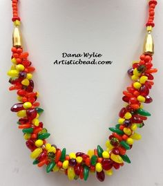 Kumihimo necklace in citrus beads and colors by Dana Wylie.  See more Kumihimo and other bead projects at www.artisticbead.com.
